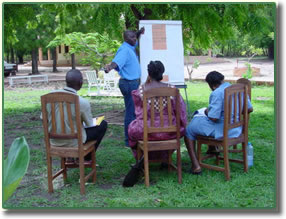 Instructor with three trainees in Benin (outdoors)