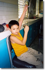 In Vietnam, a boy uses prothestic support to pull himself up