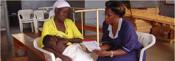 Healthcare worker uses job aid to counsel mother breastfeeding baby, Uganda